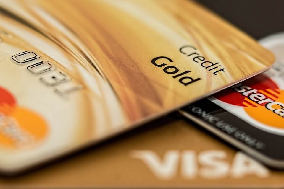 Close up shot of several gold Visa and Mastercards