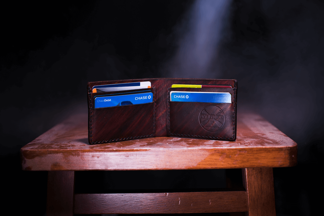 Open wallet with several credit cards visible.