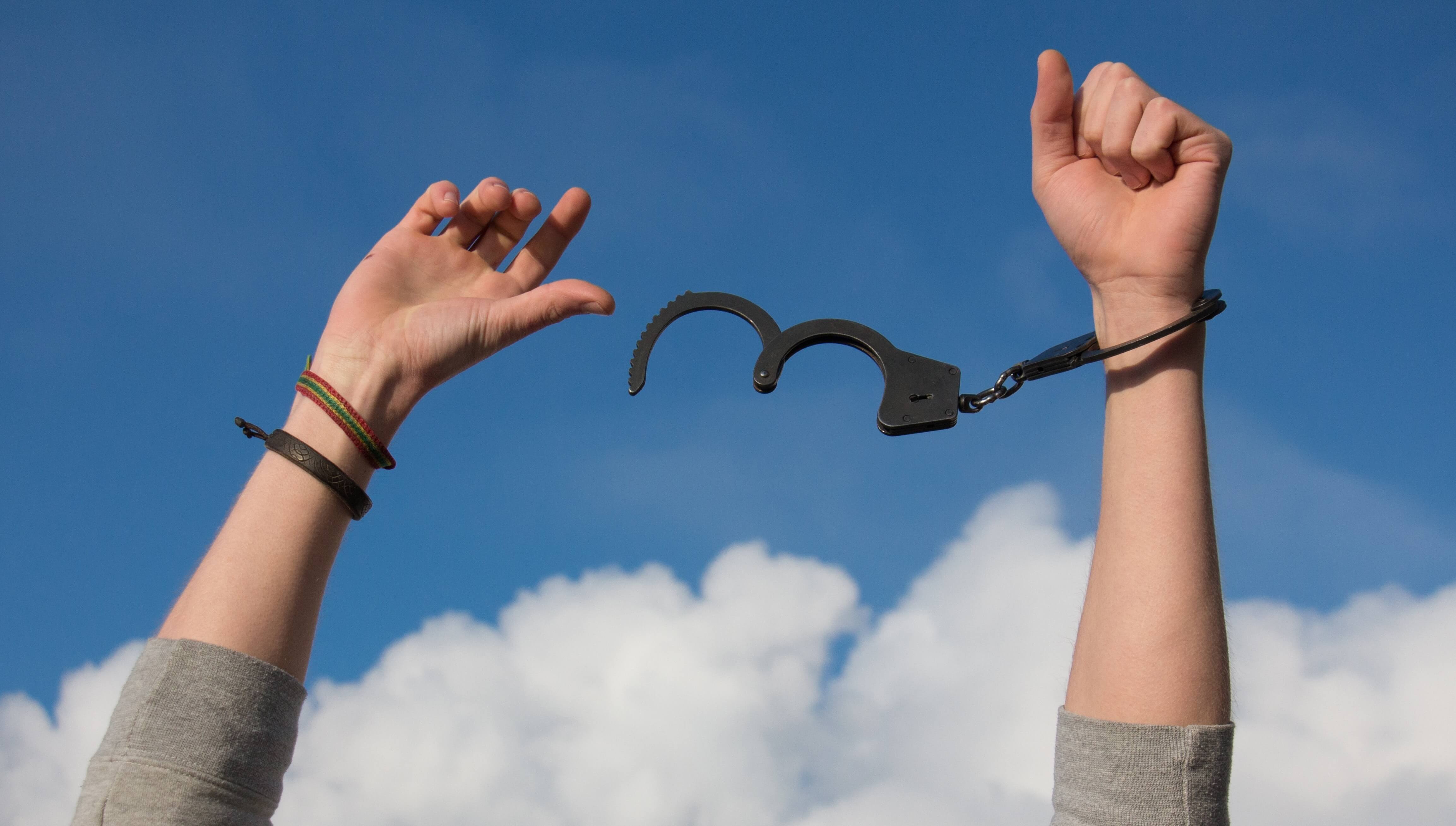 Shackles being released off someone's arms