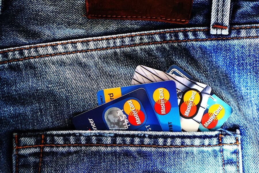 Multiple credit cards in jeans pocket