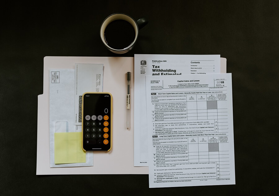 Phone on top of tax forms