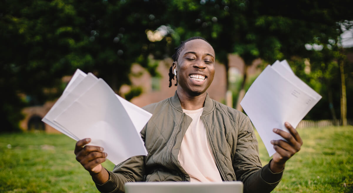 Smiling man holding papers