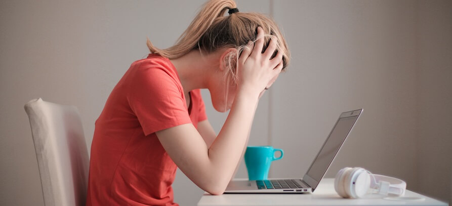 Stressed woman looking at computer screen