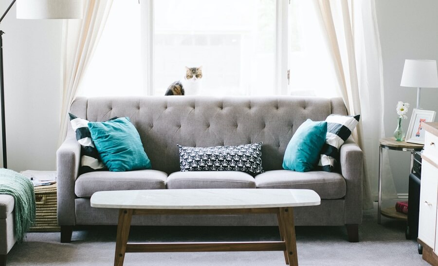 Grey couch in front of window