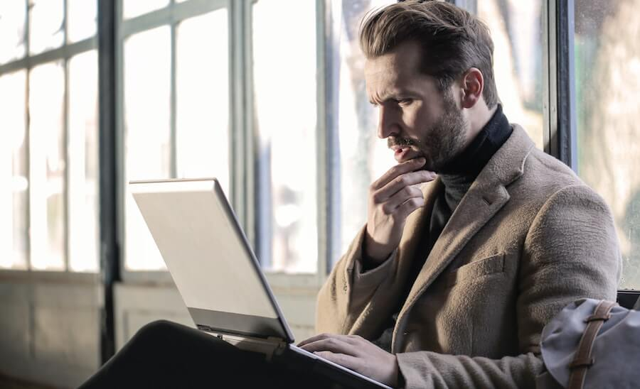 Thinking man with computer