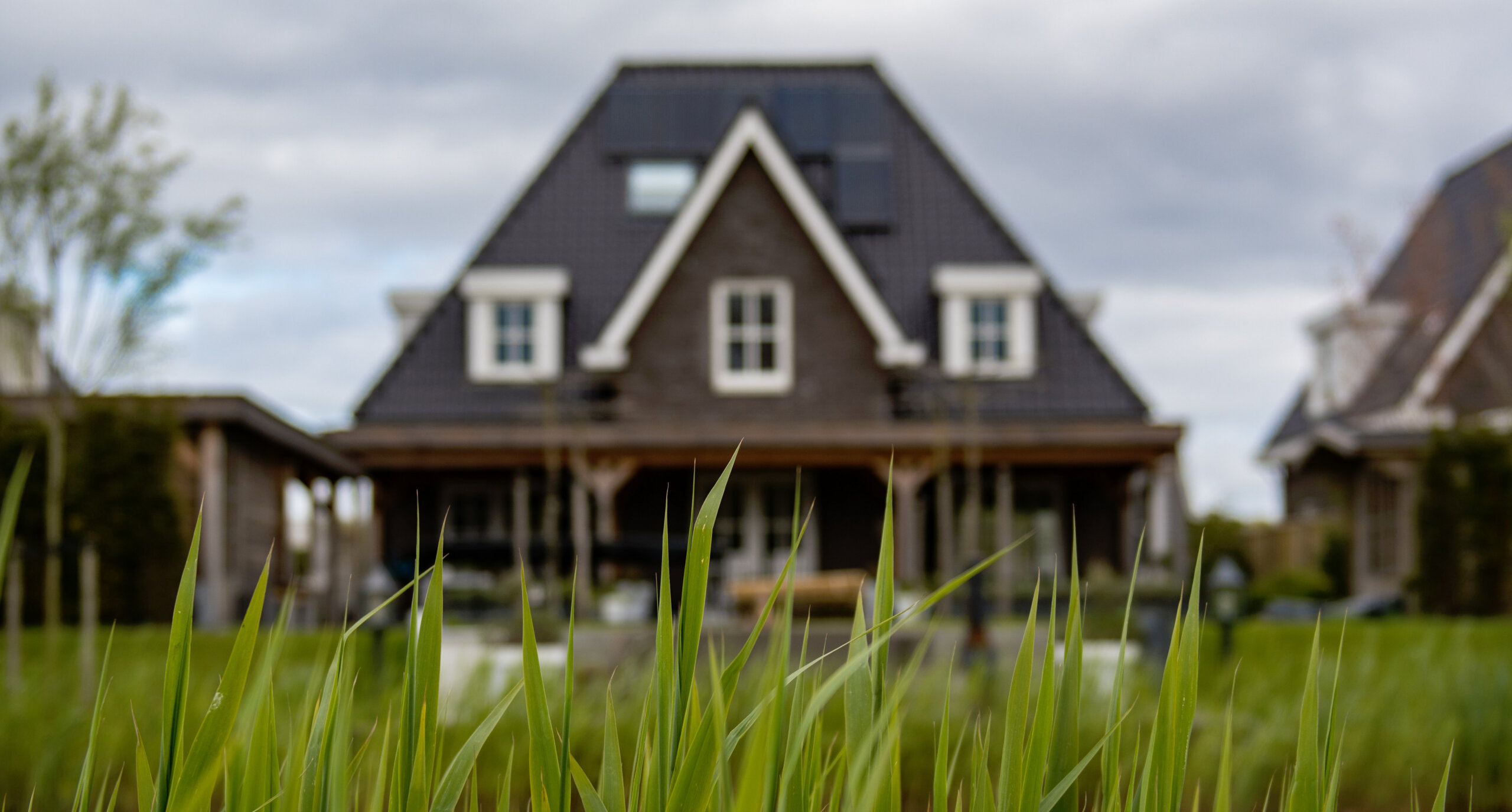 Out of focus house with grass in front